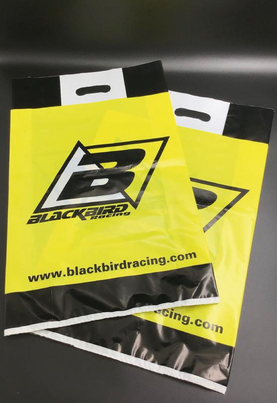 blackbird racing shopper personalizzate buste sacchetti plastica nero giallo bianco stampa logo maniglia fustellata fagiolo rifipack