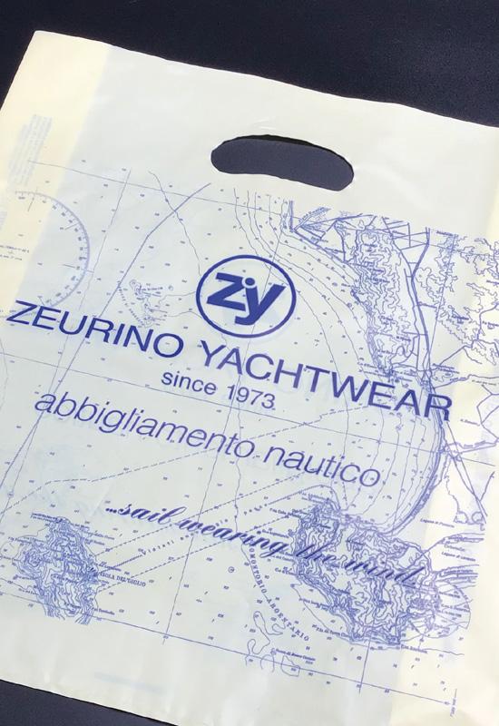 buste shopper personalizzate plastica colorata lucida opaca maniglia fustellata fagiolo coprenza stampa abbigliamento nautico zeurino yacht rifipack